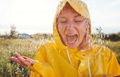 Unhappy Woman In Rain Wearing Waterproof Coat At Outdoor Music Festival poster