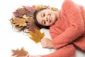 Little Girl Gorgeous Long Hair And Fallen Maple Leaves Lay On White Background. Deep Conditioning Tr poster