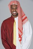 Middle Eastern man wearing traditional dress and business attire