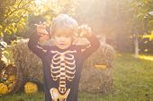 Halloween Skeleton Child. Halloween Kids Costume Party. Happy Laughing Child In Costume To Halloween poster