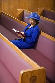 stock photo of piety  - Senior African American woman in church - JPG