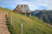 A Traditional House In Lukomir Village, Overlooking Rakitnica Canyon. Lukomir Is Bosnia Highest Vill poster