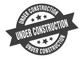 Under Construction Sign. Under Construction Black Round Ribbon Sticker poster