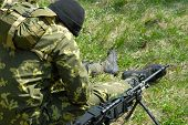 pic of hider  - The soldier with the weapon during war - JPG
