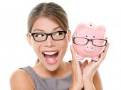Save money on glasses eyewear. Woman happy and excited over savings on buying eyewear glasses. Piggy