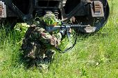 stock photo of hider  - The soldier in protective clothes with weapon - JPG