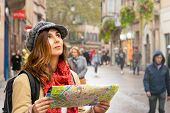 Traveler Woman With Map In Vacation. Woman Traveler In Vacation. Woman Traveling Alone With Map In V poster