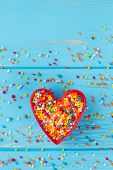 Heart-shaped Cookie Cutter Filled With Colorful Sprinkles. Valentines Holiday Background With Colorf poster