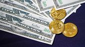 Bitcoins On The Background Of Dollars. Golden Bitcoins. New Virtual Money. Symbolic Coins Of Bitcoin poster