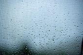 Raindrops On A Mosquito Net. Mosquito Net On A Window With A Curtain. Horizontal Photo, Macro poster