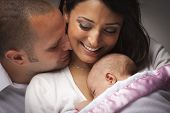 image of snuggle  - Happy Young Attractive Mixed Race Family with Newborn Baby - JPG