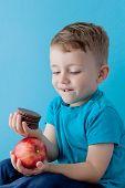 Portrait Happy, Smiling Boy Choosing Junk Food. Healthy Versus Unhealthy Food. Healthy Vs Unhealthy  poster