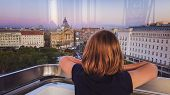 A Girl Looks From The Cab Of A Ferris Wheel In Budapest To The City Center. Budapest Eye poster