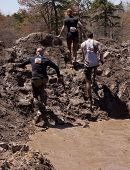 POCONO MANOR, PA - APR 29: Participants walk through several pits of mud and water at Tough Mudder o