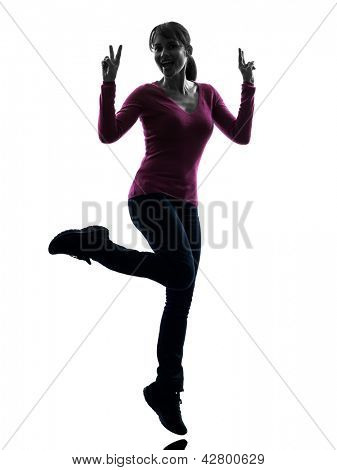 one caucasian woman happy full length peace gesture  in silhouette studio isolated on white background