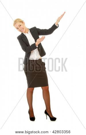 A full length portrait business woman shows something, isolated on white background