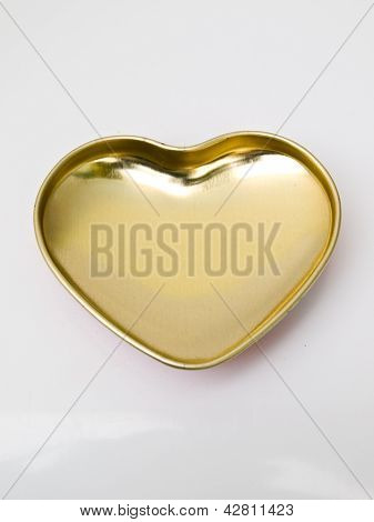A Golden Stainless Steel Heart Isolated On White Background