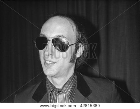 CROYDON, ENGLAND - JUNE 4: Cyril Jordan, founding member of cult San Francisco band The Flamin' Groovies, poses after a live performance on June 4, 1978 in Croydon, England.