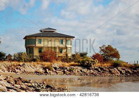 A house by ocean with autumn foliage