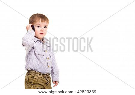 Beautiful little boy talking on a mobile phone