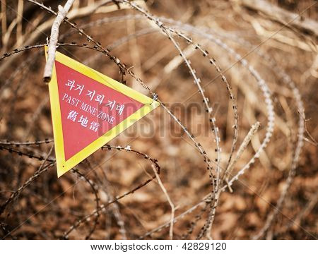 A sign indicating the end of a landmine zone in South Korea, a poignant reminder of the unresolved conflict in the region.