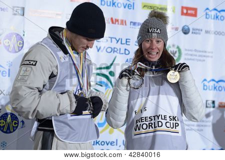 BUKOVEL, UKRAINE - FEBRUARY 23: Winners in aerial skiing Emily Cook, USA (right) and David Morris, Australia on award ceremony during Freestyle Ski World Cup in Bukovel, Ukraine on February 23, 2013