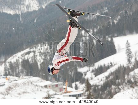 BBUKOVEL, UKRAINE - FEBRUARY 23: Travis Gerrits, Canada performs aerial skiing during Freestyle Ski World Cup in Bukovel, Ukraine on February 23, 2013.