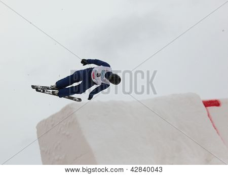 BUKOVEL, UKRAINE - FEBRUARY 23: Dmitri Dashinski, Belarus performs aerial skiing during Freestyle Ski World Cup in Bukovel, Ukraine on February 23, 2013.
