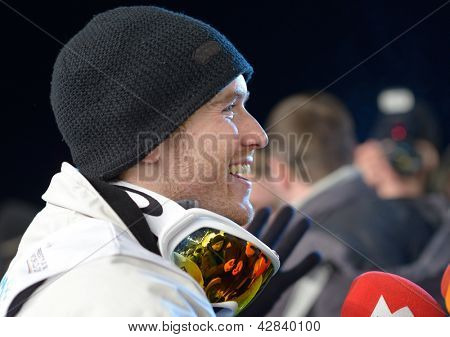 BUKOVEL, UKRAINE - FEBRUARY 23: Winner David Morris, Australia gives interview during Freestyle Ski World Cup in Bukovel, Ukraine on February 23, 2013.