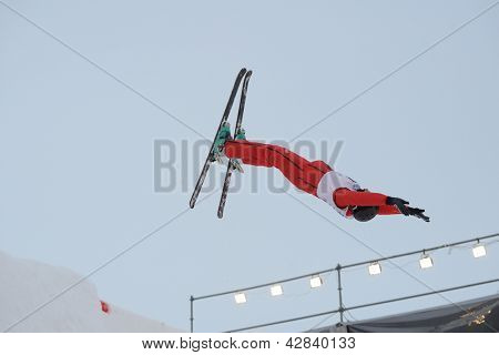 BUKOVEL, UKRAINE - FEBRUARY 23: Christopher Lambert, Switzerland performs aerial skiing during Freestyle Ski World Cup in Bukovel, Ukraine on February 23, 2013.