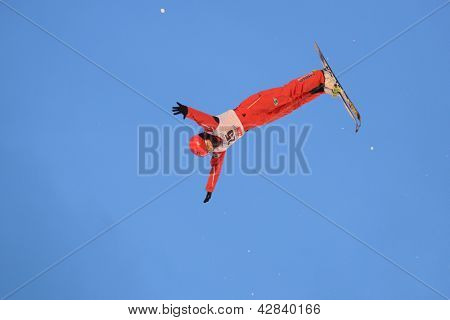BUKOVEL, UKRAINE - FEBRUARY 23: Sicun Xu, China performs aerial skiing during Freestyle Ski World Cup in Bukovel, Ukraine on February 23, 2013.