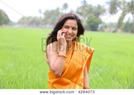 Asian Woman Walking In The Paddy Field