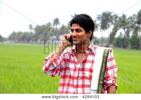 Young Farmer Talking In His Cell Phone