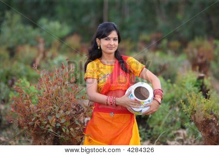 Woman Walking With An Earthen Pot