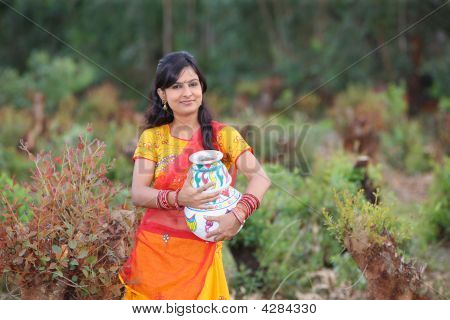 Woman With An Earthen Pot