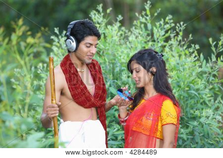 An Asian Rural Couple Of Indian Origin With Headphones