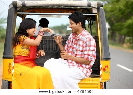 An Asian Couple Traveling In A Automobile