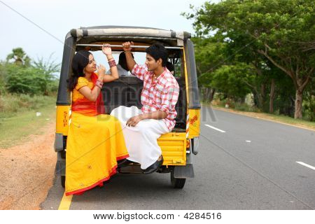 Asian Couple Traveling In A Phut-phut