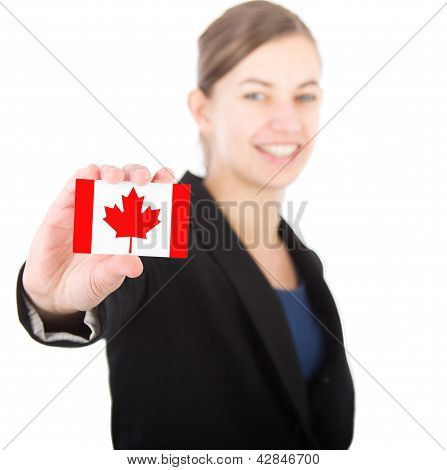 Business Woman Holding A Card With The Canadian Flag