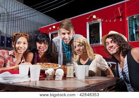 Friends Smiling Near Food Truck