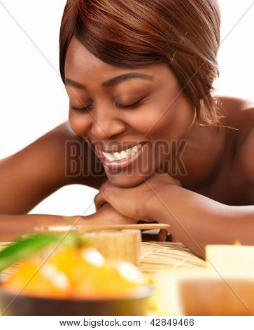 Picture of beautiful afro female with closed eyes lying down on massage table and enjoying dayspa, black young lady relaxed in luxury spa salon, skin care, healthy lifestyle, wellness concept