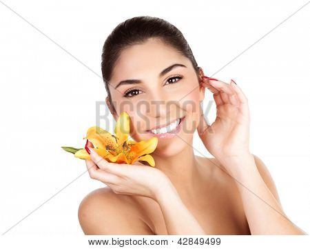 Picture of pretty woman holding in hand fresh yellow lily yellow flower, closeup portrait of girl with perfect skin isolated on white background, enjoying dayspa, luxury beauty salon, spa concept