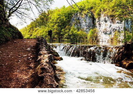 Beaten Track Near A Forest Lake And Waterfall In Plitvice Lakes National Park, Croatia