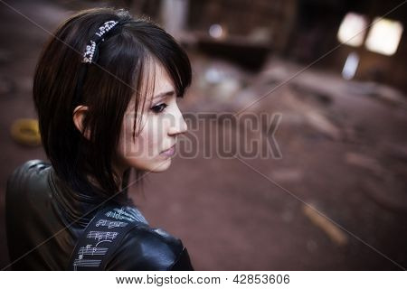 Young beautiful pensive urban woman portrait.