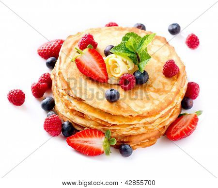 Pancakes. Crepes With Berries. Pancake stack with Strawberry, Raspberry, Blueberry  isolated on a White Background