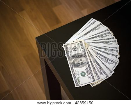 Fanned Pile Of Hundred Dollar Notes On A Table