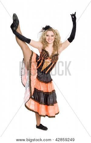 Expressive young girl doing a dance split.