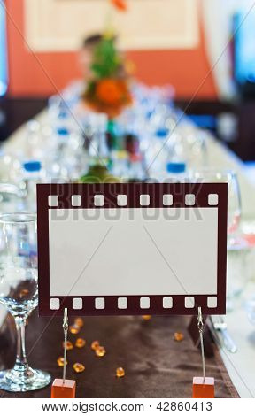 Movie Film Sign For An Official Dinner Table