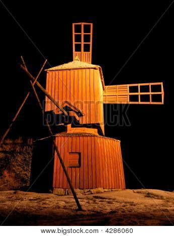 Wooden Windmill At Night