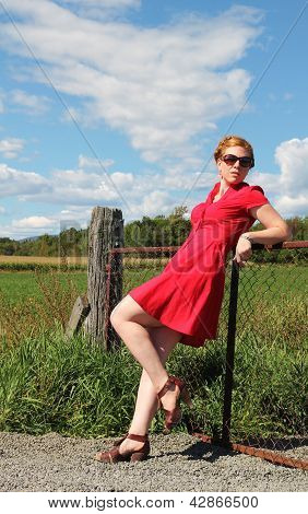 Woman Along A Fence